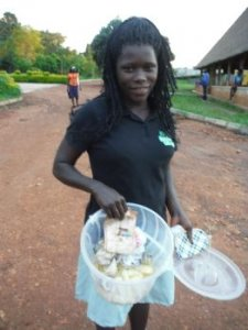 Dorcus showing off her cassava chips she has made for sale.