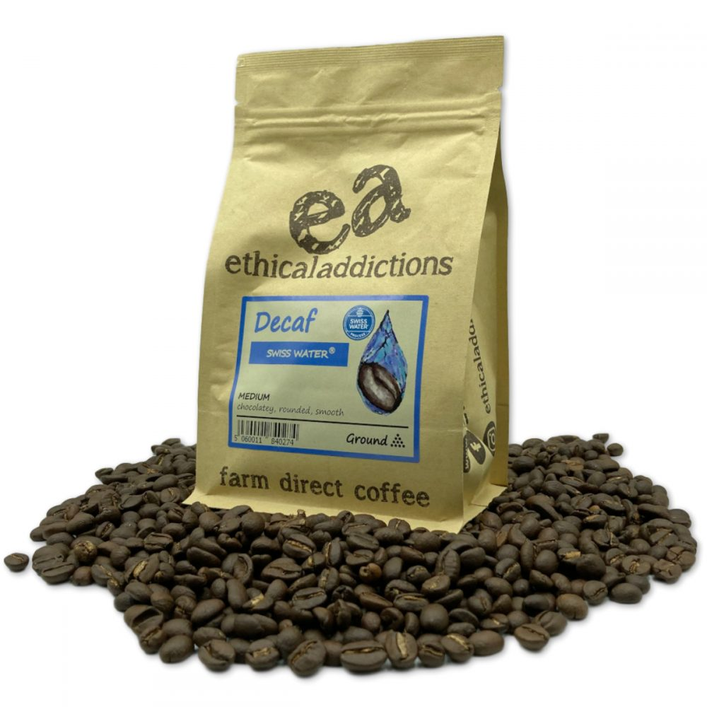 Ethical Bean Decaf bag surrounded by roasted beans